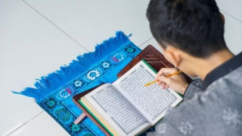 A Muslim reading and learning Quran