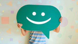 A boy hold a happy face emoji
